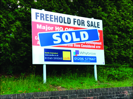 Whybrow commercial site board with Sold message applied